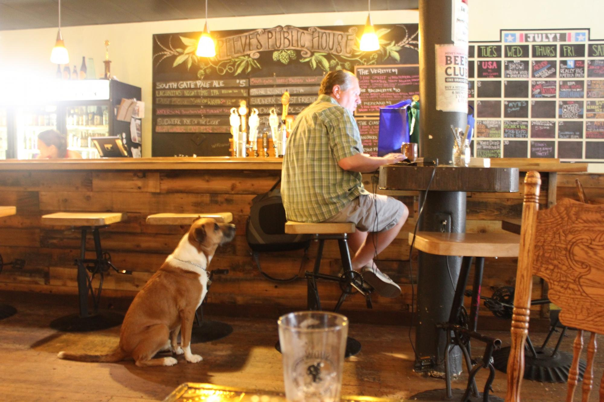 Owner Craig and his dog Peeve. Photo via Tripadvisor.com